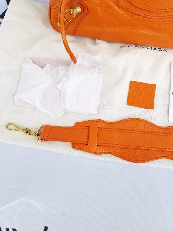 Authentic Balenciaga First in tangerin pawn