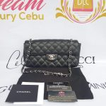 Authentic Chanel east west chain clutch in black caviar silver hardware