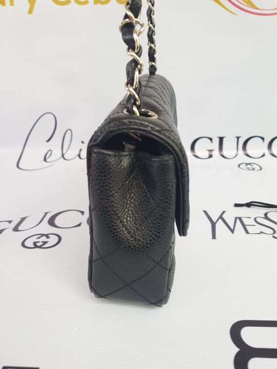 Authentic Chanel east west chain clutch in black caviar silver hardware price