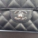 Authentic Chanel east west chain clutch in black caviar silver hardware pre-loved