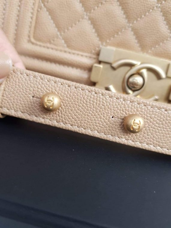 Unused Chanel le boy in small size caviar leather pawn