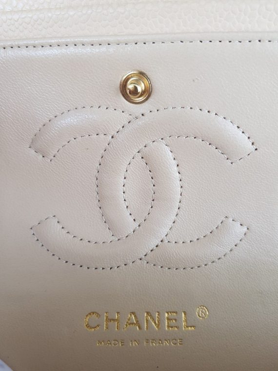 Authentic Chanel classic double flap medium in caviar leather Gold hardware how much