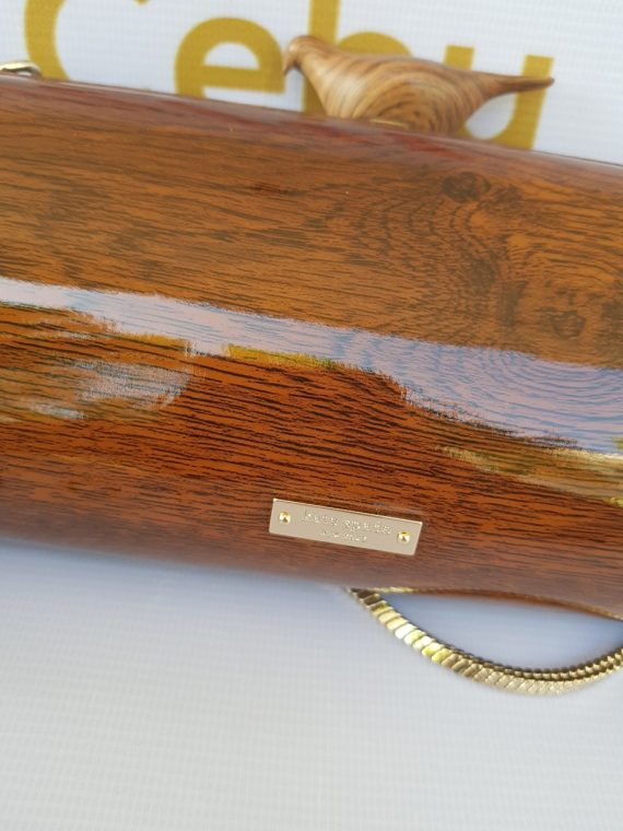 how much Limited Edition Kate Spade Wooden Bird Clutch